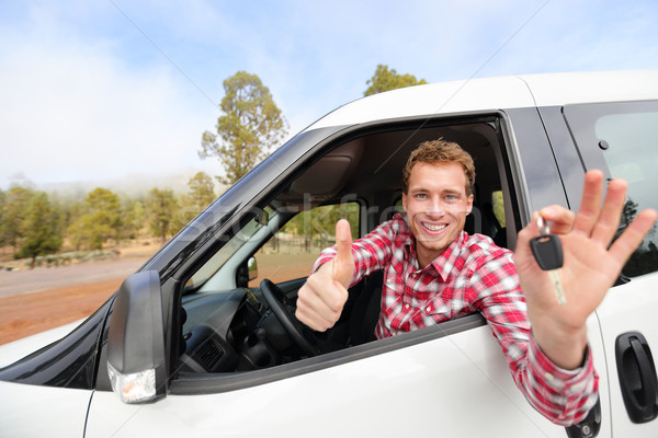 Car driver showing car keys and thumbs up happy Stock photo © Maridav