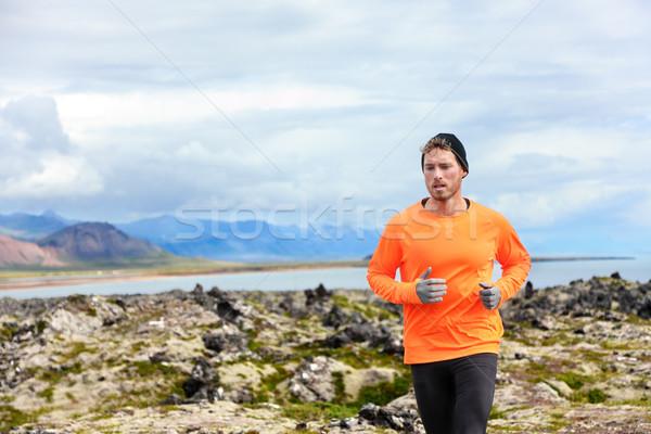 Sport running man in cross country trail run Stock photo © Maridav