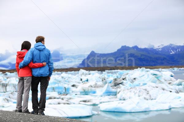 Tourists couple romantic on Iceland Jokulsarlon Stock photo © Maridav