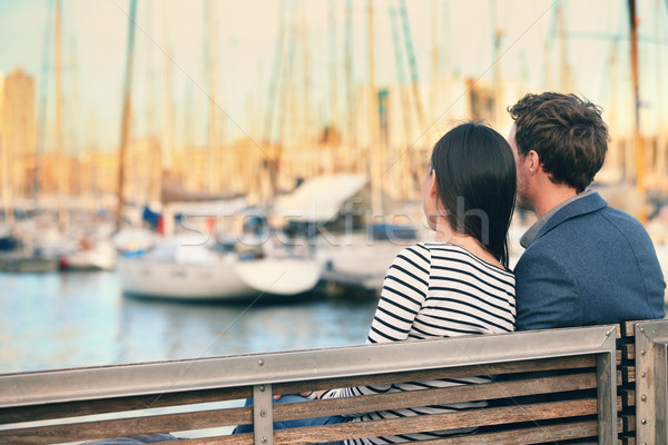 Lovers couple dating on bench in harbour Barcelona Stock photo © Maridav