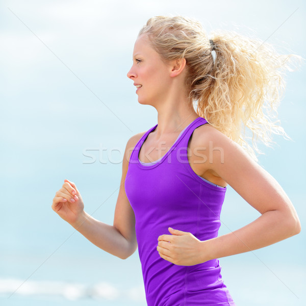 Determined Woman Runner Jogging and Running Stock photo © Maridav