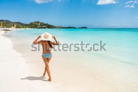 Beautiful bikini woman walking on white sand beach Stock photo © Maridav