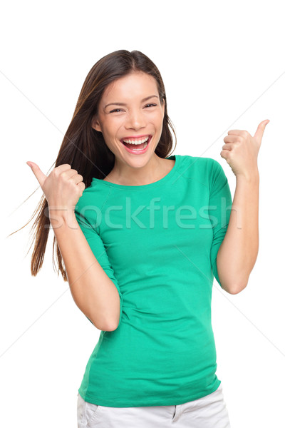 Thumbs up happy excited woman isolated Stock photo © Maridav