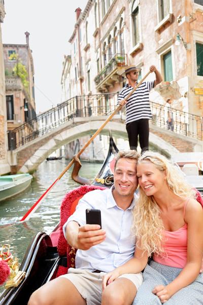 Travel couple in Venice on Gondole ride romance Stock photo © Maridav