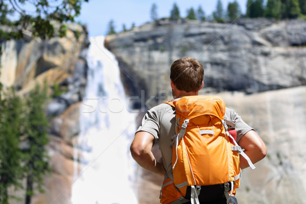 Hiker hiking looking at waterfall in Yosemite park Stock photo © Maridav