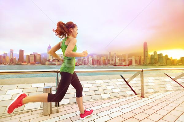 городского Runner женщину бег Гонконг закат Сток-фото © Maridav