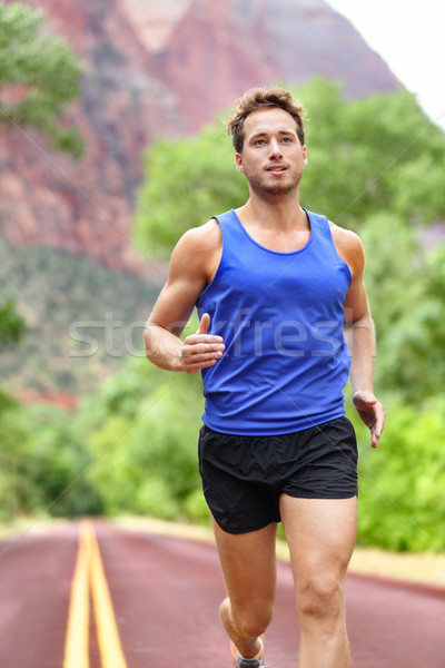 Sport and fitness runner man running on road Stock photo © Maridav
