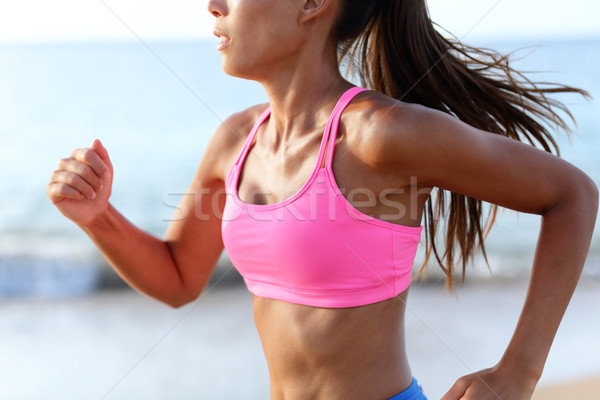 Running Determined Sprinting Woman Runner On Beach Stock photo © Maridav