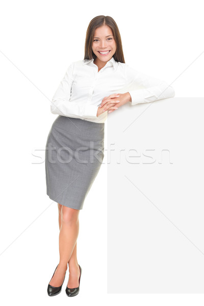 Young businesswoman leaning on sign Stock photo © Maridav