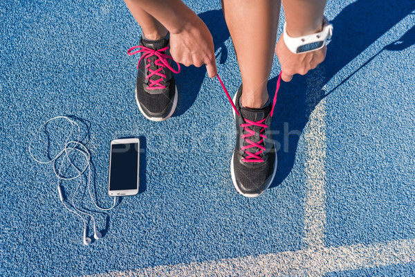 Runner tying running shoes laces on race run track Stock photo © Maridav
