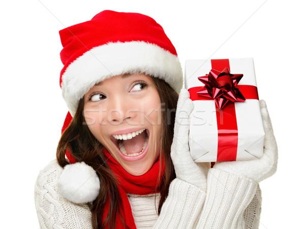 Karácsony nő tart ajándék izgatott fiatal Stock fotó © Maridav