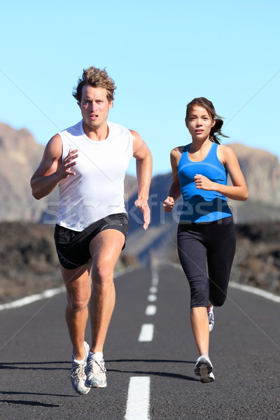 Running couple Stock photo © Maridav