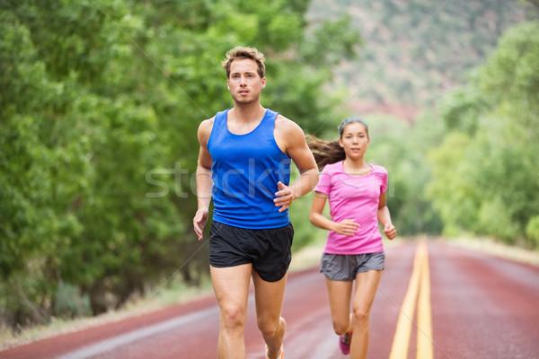 ランナー カップル を実行して 訓練 マラソン 道路 ストックフォト © Maridav