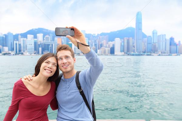 Selfie tourist couple taking picture in Hong Kong Stock photo © Maridav