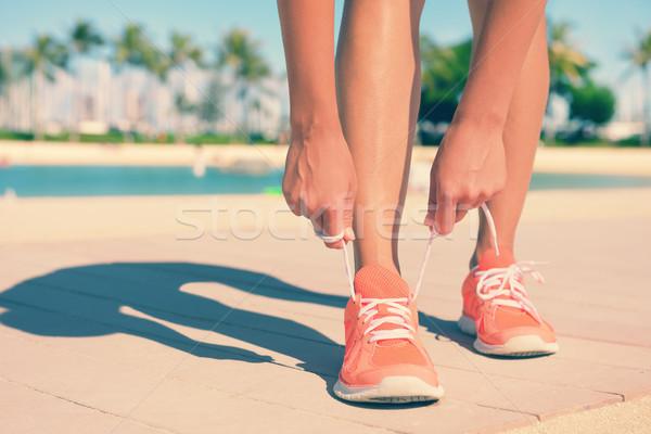 Feet Of Fit Woman Tying Sports Shoe Lace Stock photo © Maridav