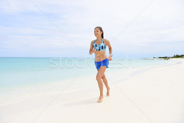 Jogging on beach - healthy fitness woman lifestyle Stock photo © Maridav