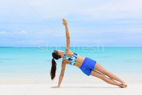 Fitness woman strength training core side plank Stock photo © Maridav