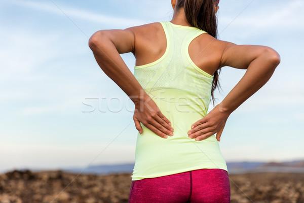 Trail running runner with lower back pain Stock photo © Maridav