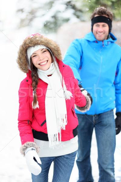 Happy winter couple in snow Stock photo © Maridav