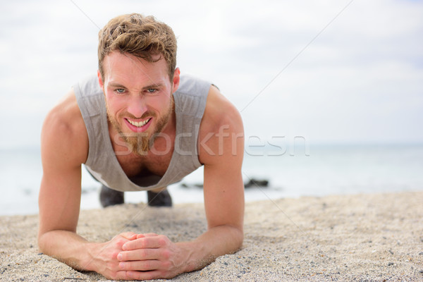 Core exercise - fitness man doing plank outside Stock photo © Maridav