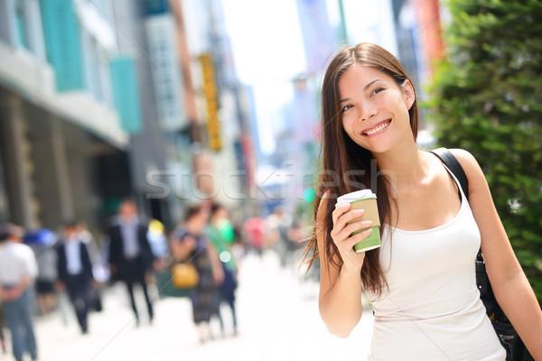 Tokyo city woman commuter walking drinking coffee Stock photo © Maridav