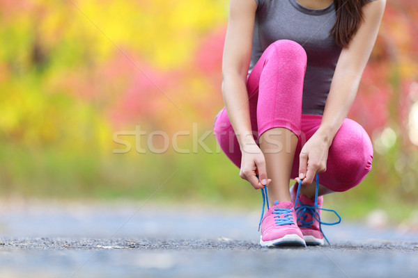 Running shoes - woman tying shoe laces closeup of Stock photo © Maridav
