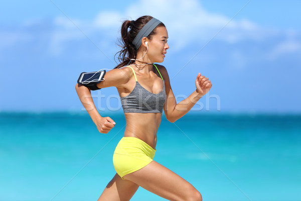 Athlete running woman runner listening to music Stock photo © Maridav