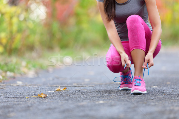 Running shoes woman runner tying shoe lace for run Stock photo © Maridav