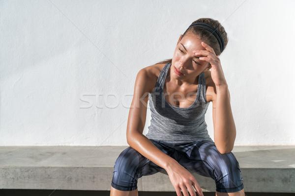 Tired fitness running woman sweating exhausted Stock photo © Maridav