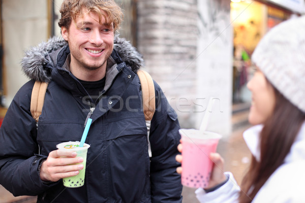 Friends in city drinking bubble tea Stock photo © Maridav