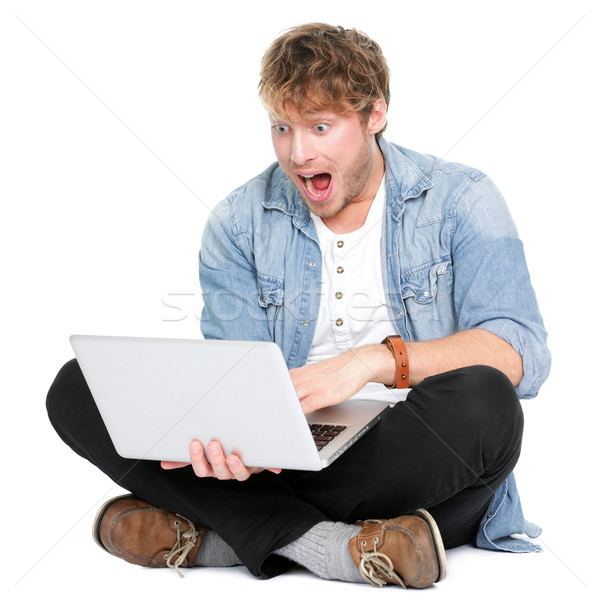Man surprised with laptop computer Stock photo © Maridav