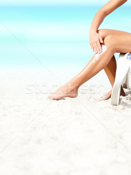 Opalenizna mleczko kosmetyczne krem do opalania kobieta krem Zdjęcia stock © Maridav