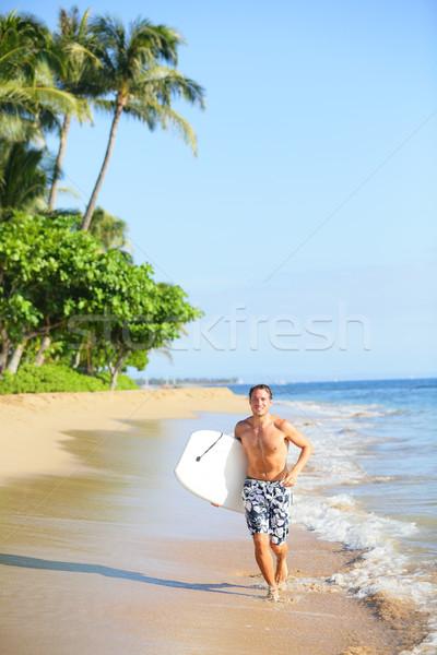 Tengerpart életstílus férfi szörfös szörfözik fut Stock fotó © Maridav