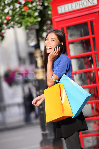 London woman talking happy smart phone shopping Stock photo © Maridav