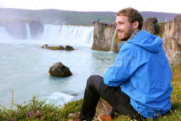 Iceland tourist relaxing by waterfall Godafoss Stock photo © Maridav