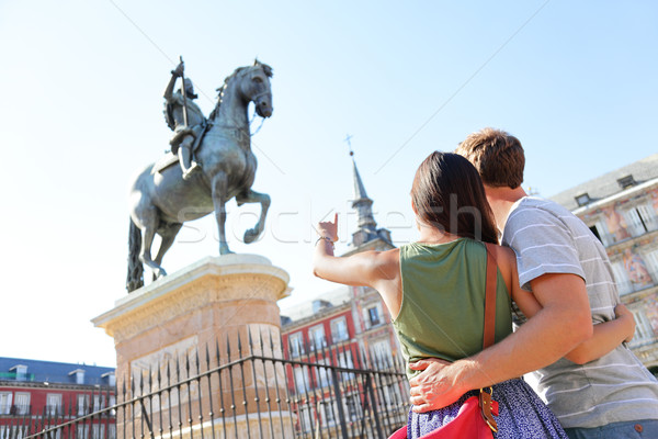 Madrid tourists on Plaza Mayor looking at statue Stock photo © Maridav
