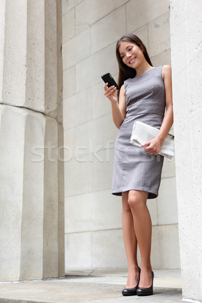Business woman lawyer reading app on smartphone Stock photo © Maridav