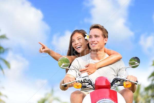 Happy couple pointing on scooter travel vacation Stock photo © Maridav