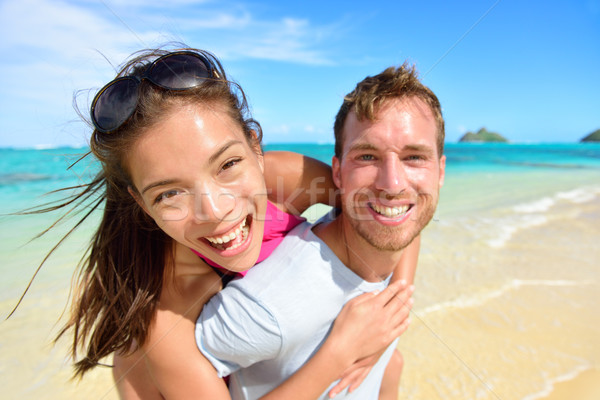 Happy beach couple in love on summer vacations Stock photo © Maridav