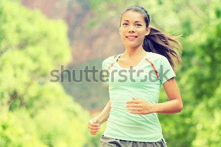 Fiatal nő jogging park mosolyog gyönyörű félvér Stock fotó © Maridav