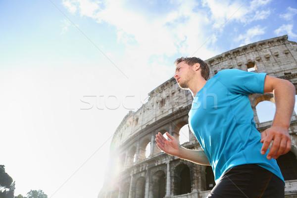 Futó jogging fut Colosseum férfi férfi Stock fotó © Maridav