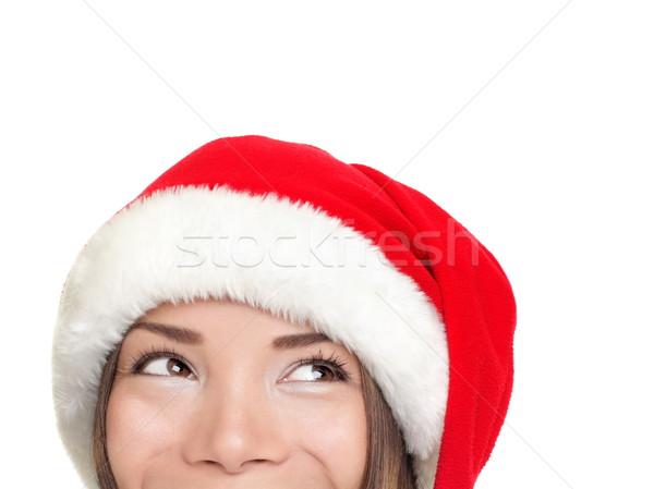Santa hat christmas woman looking up Stock photo © Maridav