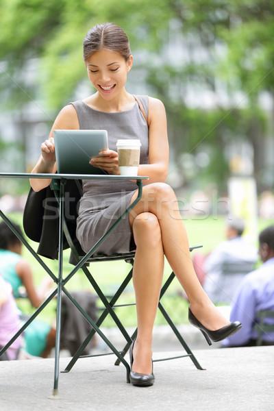 Businesswoman on break in park Stock photo © Maridav