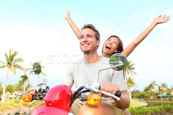 Happy free freedom couple driving scooter Stock photo © Maridav