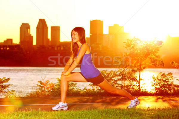 Woman runner stretching legs after running Stock photo © Maridav