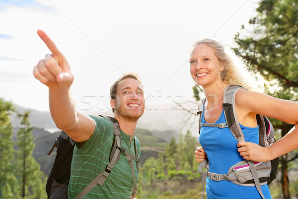 People hiking - couple on hike in forest Stock photo © Maridav