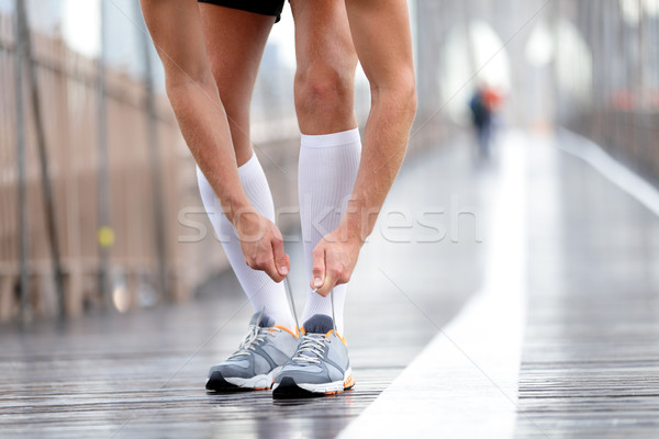 Running shoes - Runner man tying laces, New York Stock photo © Maridav