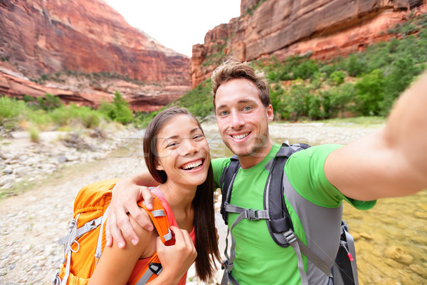 Travel hiking selfie by happy couple on hike Stock photo © Maridav