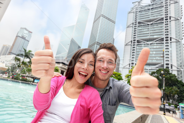 Happy thumbs up multicultural couple in Hong Kong Stock photo © Maridav