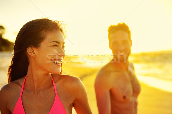 Happy multicultural couple on beach vacations Stock photo © Maridav
